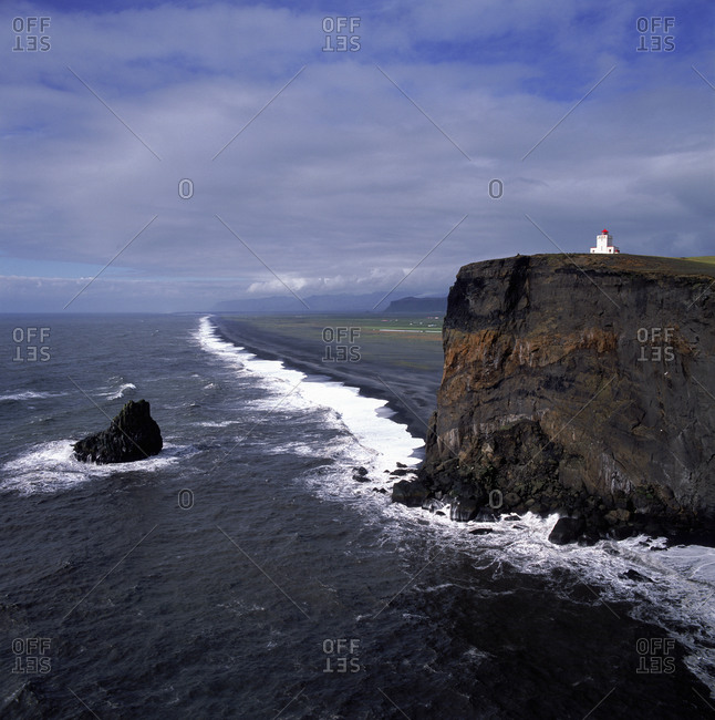 The lighthouse at Dyrholaey cliff in the south of Iceland