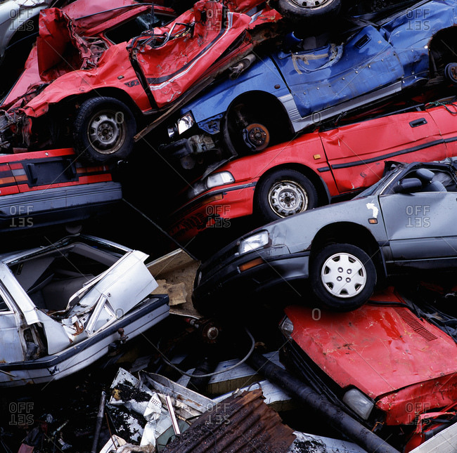 Pile of wrecked cars at a junk yard in Reykjavik / Iceland