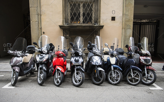 Row of scooters parked in Florence