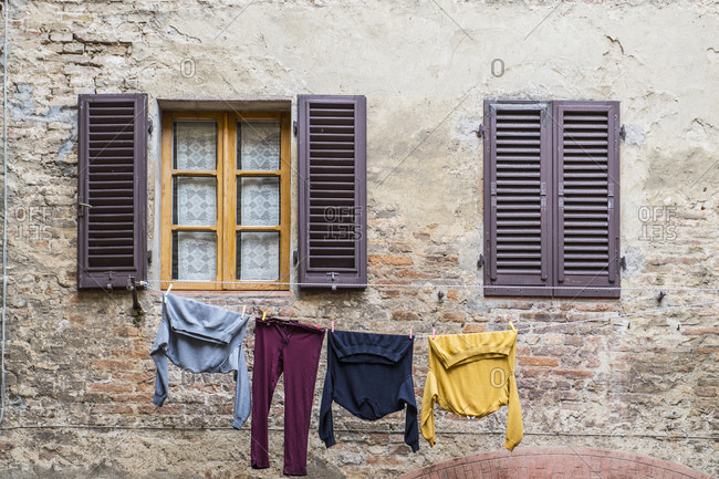 Laundry hanging outside to dry in Florence / Tuscany