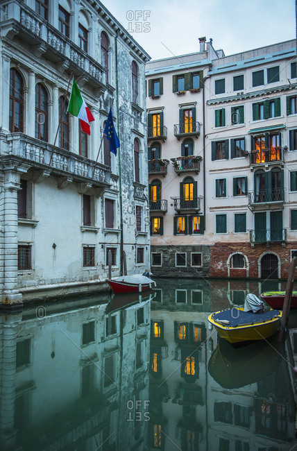 Narrow canal in Venice after sunset