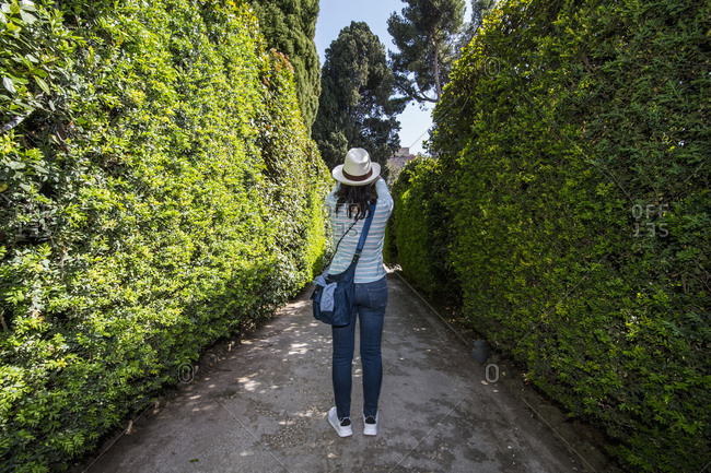 Rear view of woman taking a picture in Italian garden