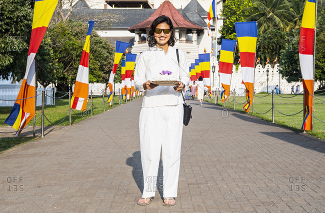 Woman on a buddhist pilgrimage trip to Kandy / Sri Lanka
