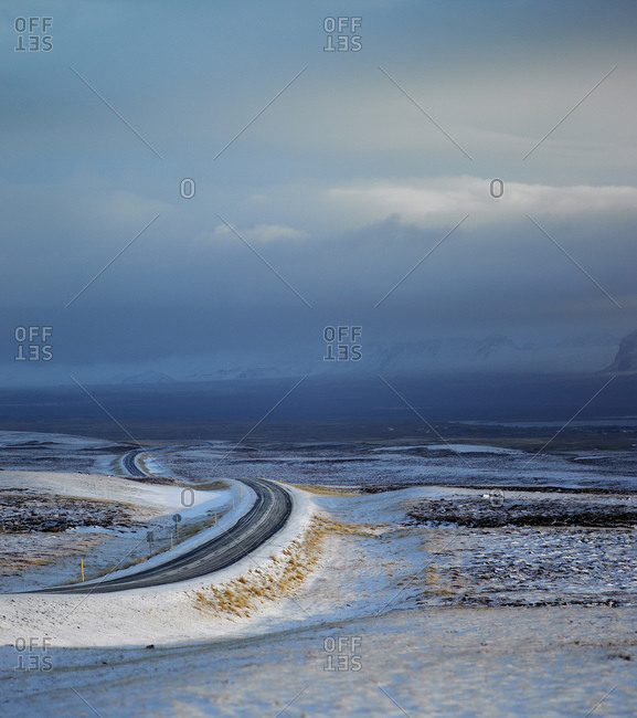 Rural road through snowy terrain in Iceland