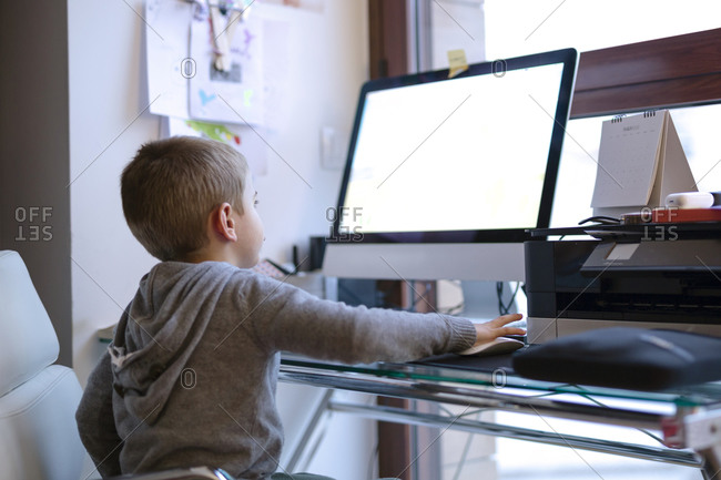 Child playing an educational game on the computer. Quarantine Covid-19