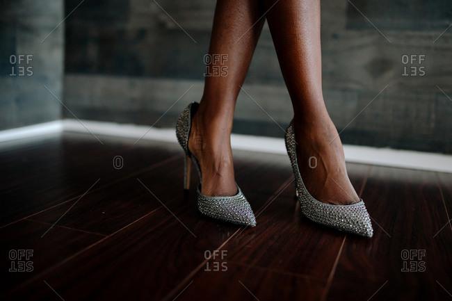 Sexy ethnic feet wearing classy silver rhinestone high heels