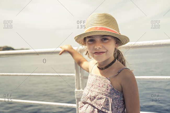 Girl in sunhat on pier, Portoferraio, Tuscany, Italy