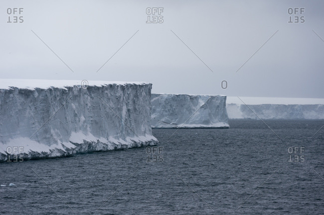 Arctic ocean and ice cliffs of  polar ice cap, Austfonna Nordaustlandet, Svalbard, Norway