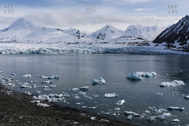 Coastal landscape with sea ice and snow covered mountains, Isbjornhamna, Hornsund bay, Spitsbergen, Svalbard, Norway