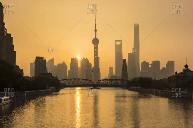 Golden sunset over Waibaidu Bridge and Pudong skyline, Shanghai, China