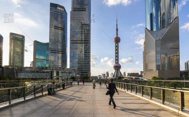 January 31, 2019: Pudong skyline with Oriental Pearl Tower from elevated walkway, Shanghai, China