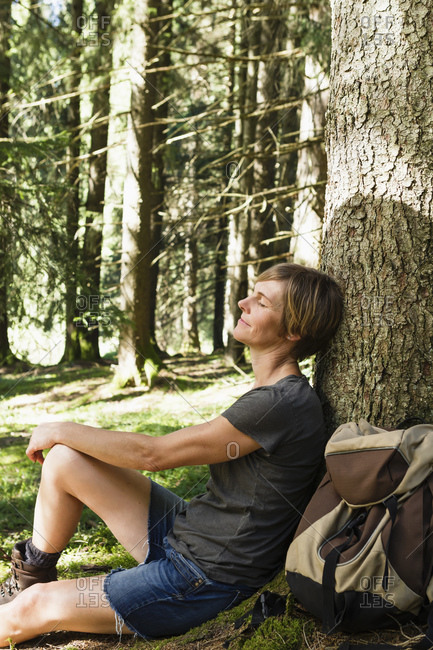 Woman relaxing in forest, Sonthofen, Bayern, Germany