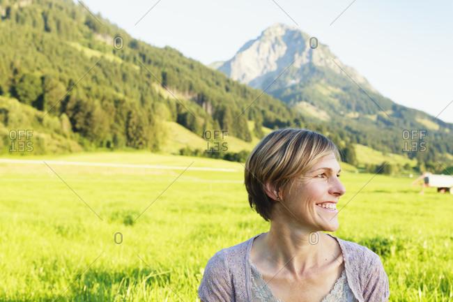 Woman enjoying countryside, Sonthofen, Bayern, Germany