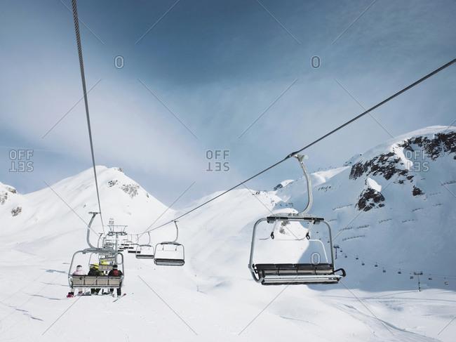 Ski lift in snow covered mountain landscape,  Alpe Ciamporino, Piemonte, Italy