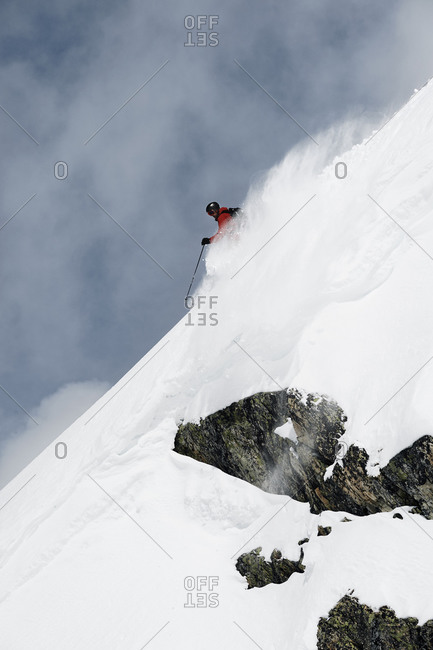 Male skier speeding down steep mountainside, Alpe-d'Huez, Rhone-Alpes, France