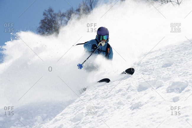 Male skier swerve skiing down mountain, Alpe-d\'Huez, Rhone-Alpes, France