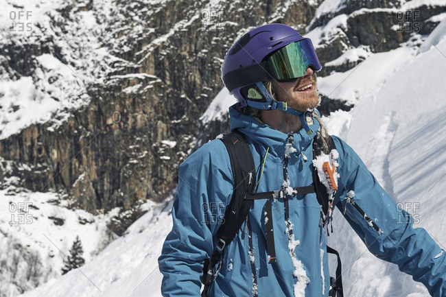 Male skier looking up mountainside, Alpe-d'Huez, Rhone-Alpes, France