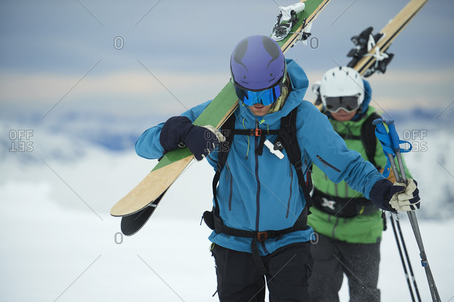 Landscape with male skiers trudging in snow, Alpe-d'Huez, Rhone-Alpes, France