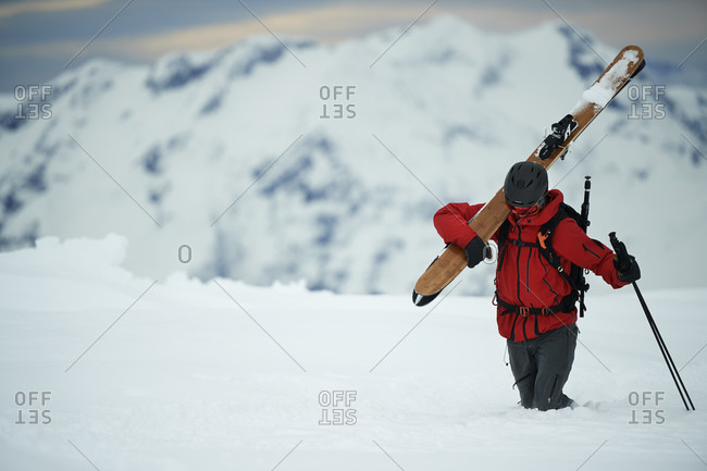 Landscape with male skier trudging in deep snow, Alpe-d'Huez, Rhone-Alpes, France