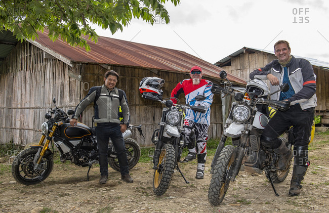Bikers posing with scrambler in Golden Triangle, Nan, Thailand