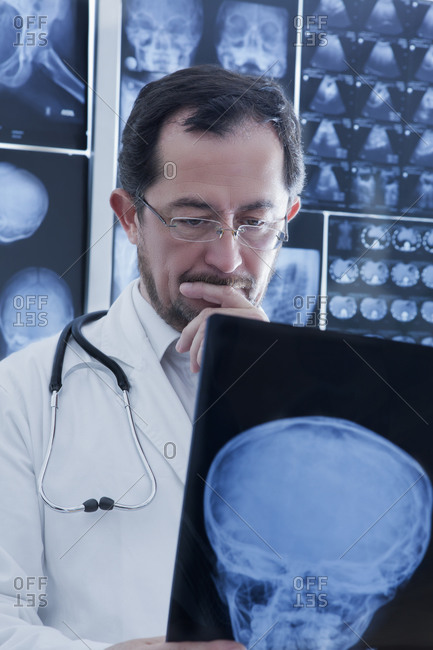 Doctor closely examining X-ray image