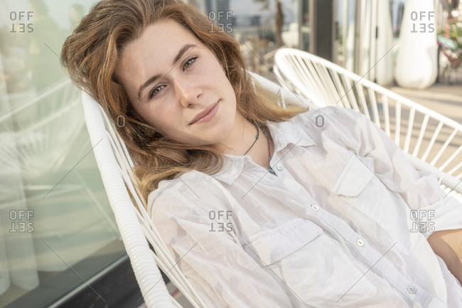 Young woman relaxing on chair outdoors