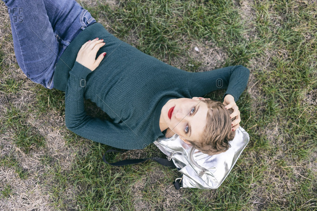 Woman lying on grass in a park