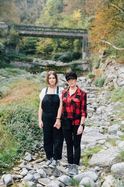 Women standing in dry riverbed, Rezzago, Lombardy, Italy
