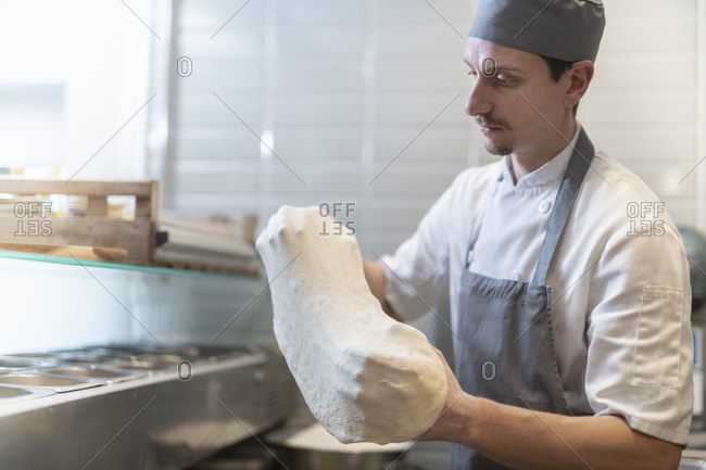 Chef shaping the dough for Pinsa Romana, a Roman style pizza blend reducing sugar and saturated fat, containing rice and soy with less gluten