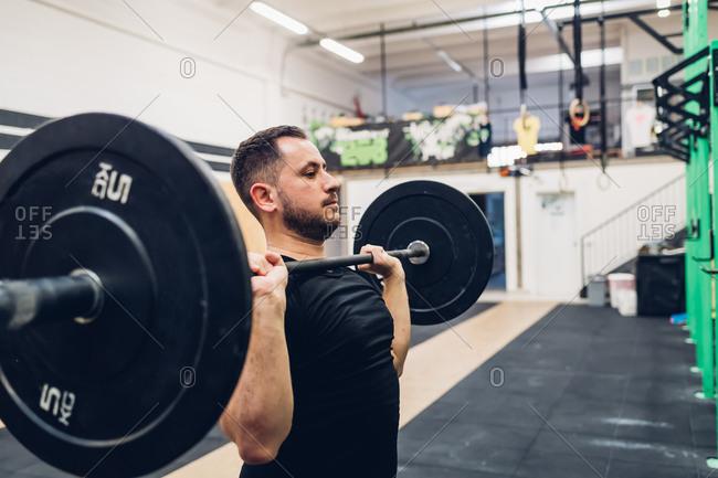 Man weight training in gym