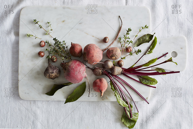 Beautiful beetroot and radish on a cutting board