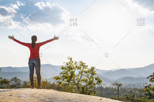 Woman exploring top of canyon, Pai, Mae Hong Son, Thailand