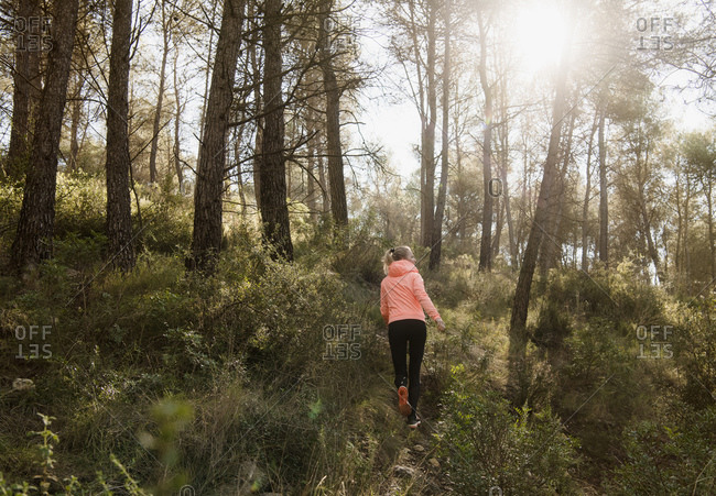 Woman exploring forest, Olivella, Catalonia, Spain