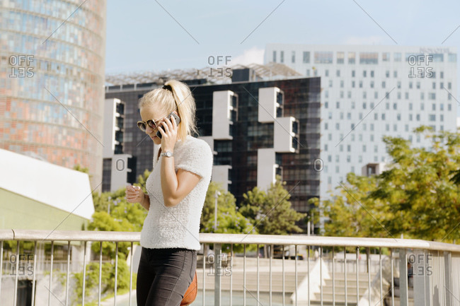 Woman using smartphone in city, Barcelona, Catalonia, Spain