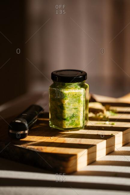 Fresh chopped green veggies in a jar