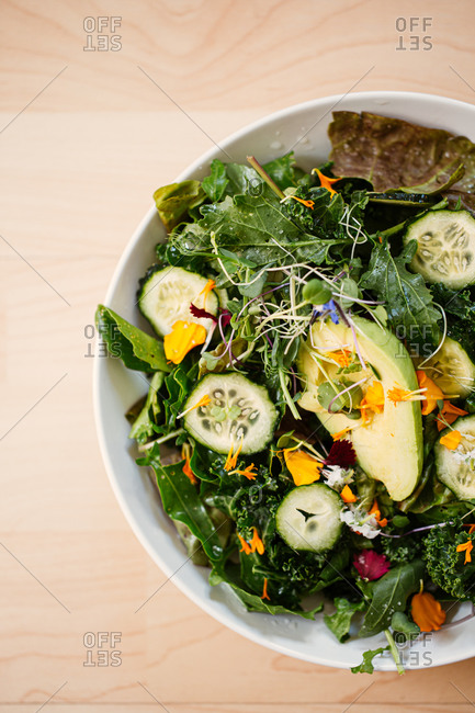 Overhead view of a nutritious salad with cucumber and avocado