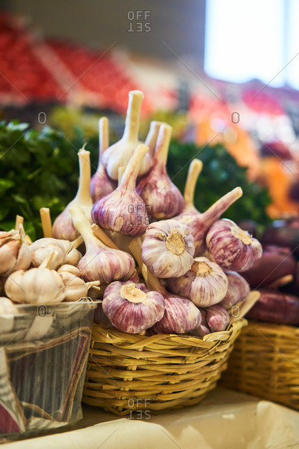Garlic in baskets at a grocery store