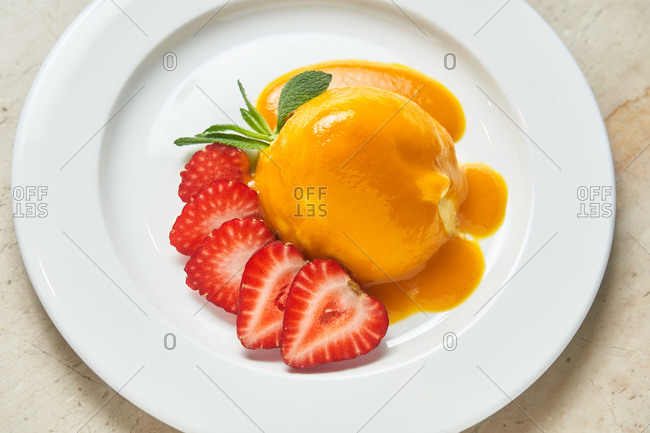 Peach dessert with strawberries