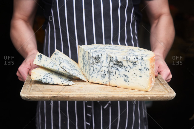Chef holding fresh block of blue cheese