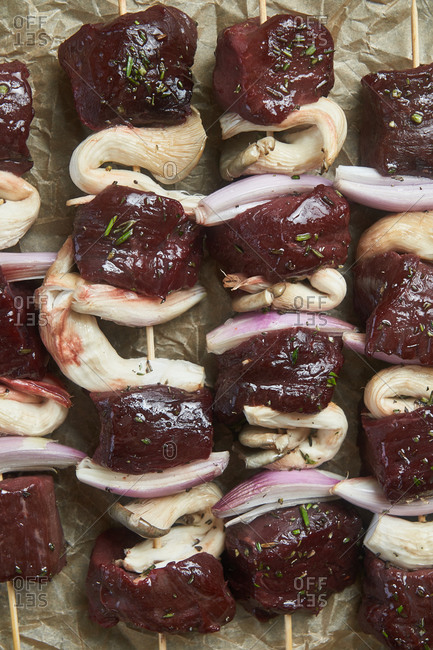 Detail of steak kabobs on parchment paper