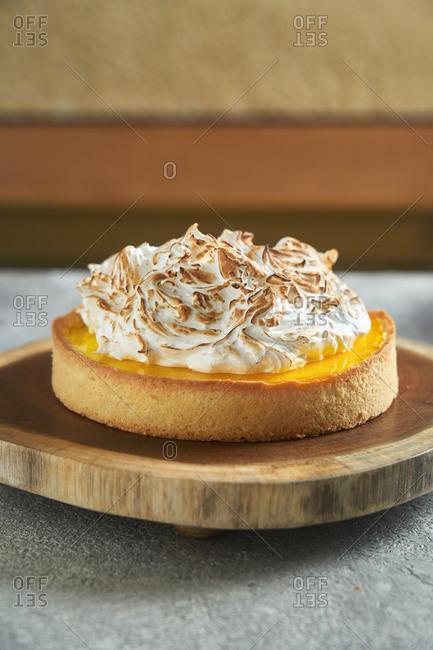 Lemon meringue tart on a wooden stand