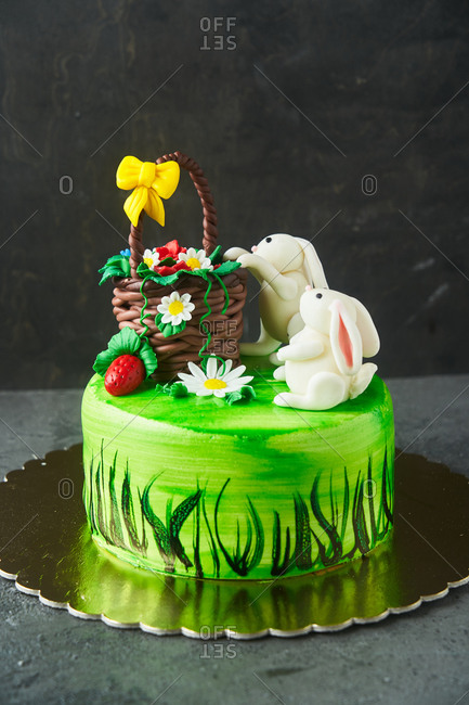 Adorable green Easter cake with bunnies and a basket