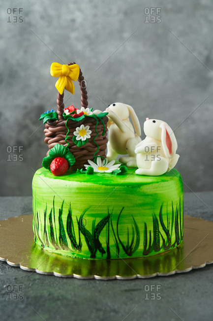 Easter cake with bunnies and a basket