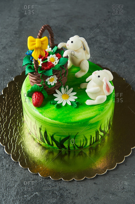 Elevated view of an Easter cake with bunnies and a basket