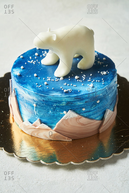 Blue cake with mountain detail and polar bear