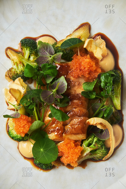 Close up of a broccoli and cod dish with caviar