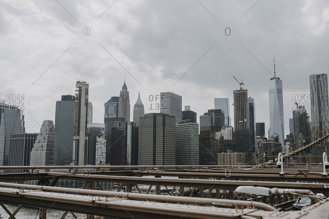 New York, New York - July 3, 029: Skyline with modern skyscrapers seen from bridge over river in cloudy summer day