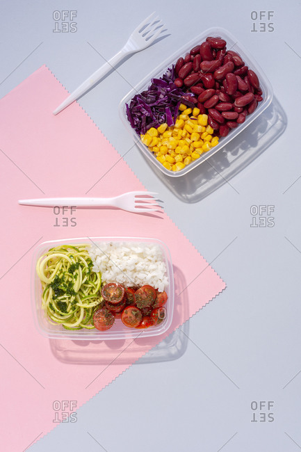 Homemade vegan food in lunch boxes with healthy vegetable fresh from above. Vegan food concept. Healthy food. Flat lay. Top view