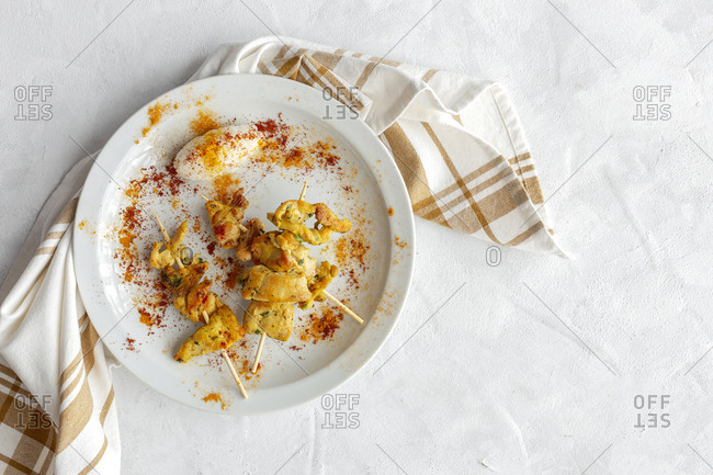 Homemade Moorish skewers with rice of meat with spices. Typical oriental food from above on white background. Flat lay. Top view