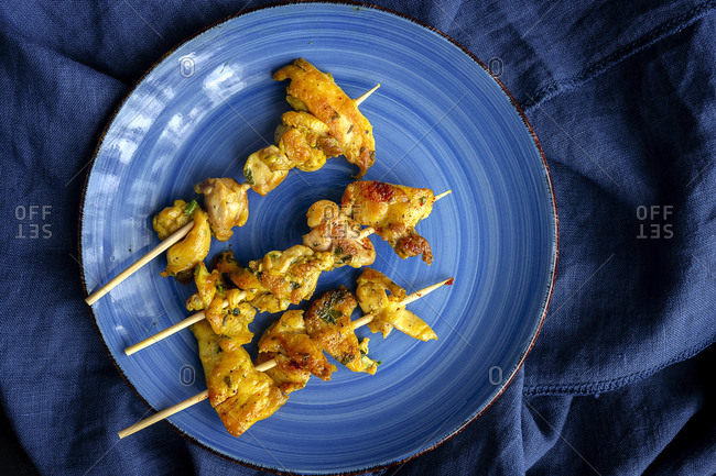 Homemade Moorish skewers with rice of meat with spices. Typical oriental food from above on dark background. Flat lay. Top view